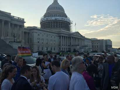 About 150-200 people gathered outside the Capitol late Wednesday to show their support of House Democrats, who continued to hold a sit-in in the House Chambers to force action on gun control legislation.