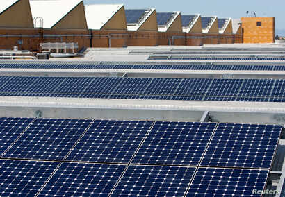 FILE - Solar panels sit on the roof of SunPower Corporation in Richmond, California, March 18, 2010.