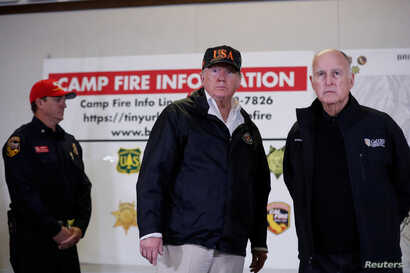 U.S. President Donald Trump and California Governor Jerry Brown participate during a briefing with State officials after visiting the charred wreckage of Skyway Villa Mobile Home and RV Park in Paradise, in Chico, California, Nov. 17, 2018.