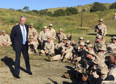 FILE - Defense Secretary Jim Mattis talks to U.S. Marines at a rifle range at Guantanamo Bay, Cuba, Dec. 21. 2017. The unannounced visit was the first by a defense secretary since Donald Rumsfeld visited in January 2002 shortly after the first prison...