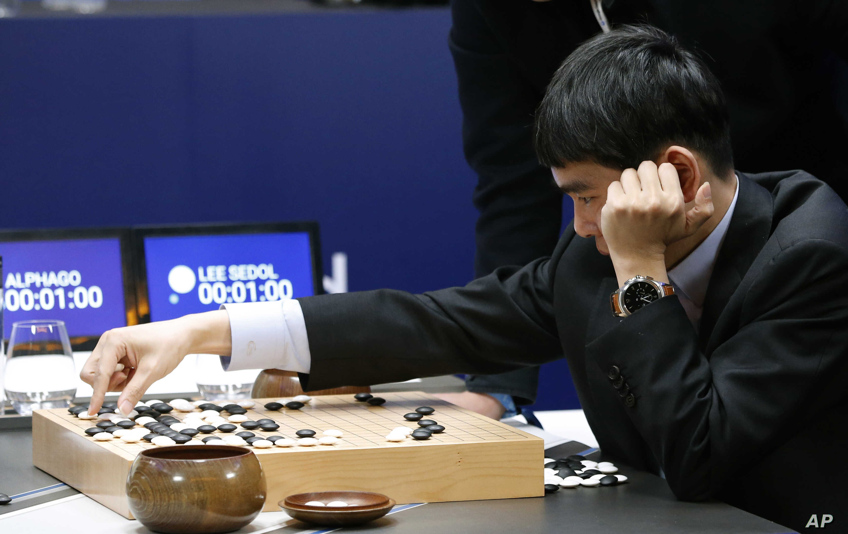 South Korean professional Go player Lee Sedol reviews the match himself after finishing the second match of the Google DeepMind Challenge Match against Google's artificial intelligence program, AlphaGo in Seoul, South Korea, March 10, 2016.