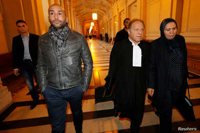 Latifa Ibn Ziaten (R), mother of French soldier Imad ibn Ziaten who was slain by Islamist militant gunmen Mohammed Merah in 2012, arrives with her lawyer and son for the trial of Abdelkader Merah, brother of Mohammed Merah, who is accused of complici...