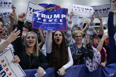 FILE - Supporters of then Republican presidential candidate Donald Trump cheer during a campaign rally, Nov. 8, 2016, in Grand Rapids, Michigan.