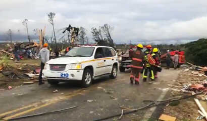 Emergency responders work in the scene amid debris in Lee County, Ala., after what appeared to be a tornado struck in the area Sunday, March 3, 2019.