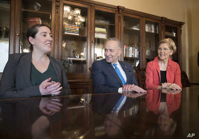 From left, Leandra English, who was elevated to interim director of the Consumer Financial Protection Bureau by its outgoing director, meets with Senate Minority Leader Chuck Schumer, D-N.Y., and Sen. Elizabeth Warren, D-Mass., on Capitol Hill in Was...
