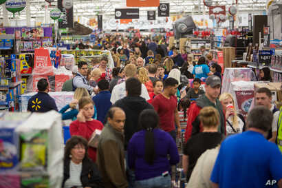 Customers save big at Walmart's Black Friday shopping event in Rogers, Ark, Nov. 26, 2015.