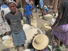 Rice merchants at local markets in Haiti say food aid cut into prices and sales.