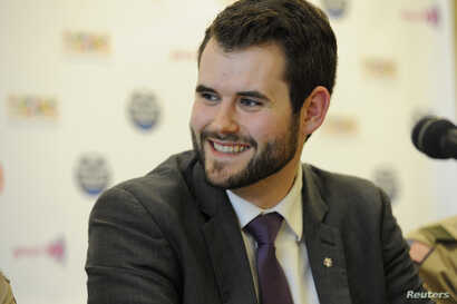 FILE - Zach Wahls, executive director of Scouts for Equality, a pro-gay organization, fields questions at a news conference in Grapevine, Texas, May 23, 2013.