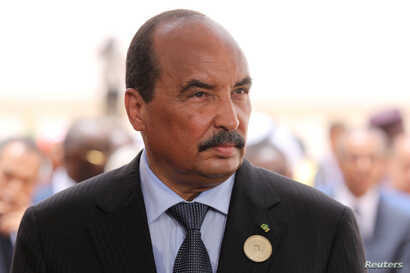 Mauritania's President Mohamed Ould Abdel Aziz waits for the arrival of the French President at Nouakchott airport, Mauritania, July 2, 2018.