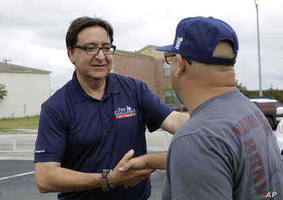 U.S. House of Representative democratic candidate Pete Gallego, left, makes a stop at a polling site, Nov. 8, 2016, in San Antonio.