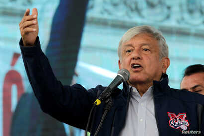 Mexico's President-elect Andres Manuel Lopez Obrador talks to supporters as he continues with his tour to thank supporters for his victory in the July 1 election in Monterrey, Oct. 19, 2018.