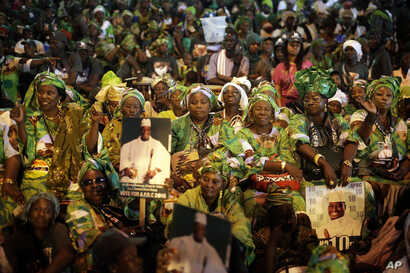 Supporters cheer Gambian President Yahya Jammeh during his final rally in Banjul, Gambia, Tuesday Nov. 29, 2016.