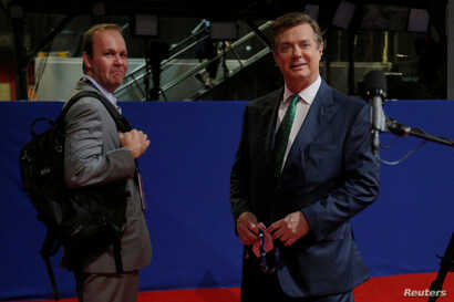 FILE - Paul Manafort, right, campaign manager to Republican Presidential Candidate Donald Trump, and his assistant Rick Gates stand on the floor of the Republican National Convention in Cleveland, July 17, 2016.