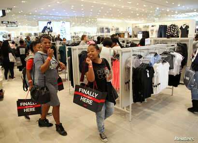 Shoppers react during the opening of the Mall of Africa in Midrand, outside Johannesburg, South Africa, April 28, 2016.