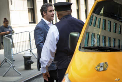 Michael Cohen, formerly a lawyer for President Trump, leaves his hotel, July 27, 2018, in New York.