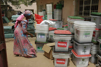 An electoral worker checks ballot boxes at the electoral commission office in Yola, Nigeria, Feb. 24, 2019.