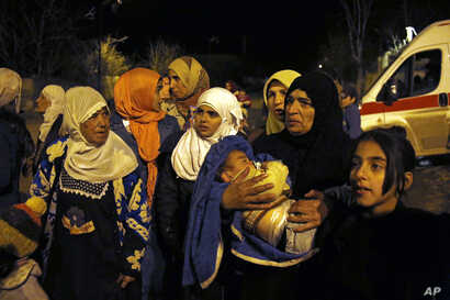 People wait to leave the besieged town of Madaya, northwest of Damascus, Syria, on Jan. 11, 2016. The U.N. humanitarian chief said about 400 people need to be evacuated immediately to receive life-saving treatment for medical conditions, malnourishme...