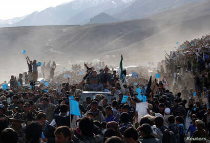 Presidential candidate Abdullah Abdullah (in grey), sitting atop a vehicle, arrives for an election campaign in Panjshir province March 31, 2014. The Afghan presidential election will be held on April 5.  REUTERS/Ahmad Masood (AFGHANISTAN - Tags: POL...