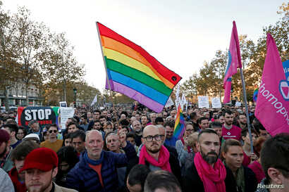 Members and supporters of the lesbian, gay, bisexual and transgender (LGBT) community protest against discrimination and violence, at the Place de la Republique in Paris, France, Oct. 21, 2018.