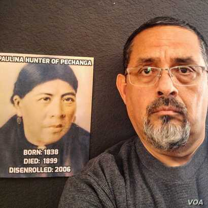 Disenrolled Luiseno Pechanga Indian Rick Cuevas stands beside a portrait of his ancestor, Paulina Hunter, who was stripped of tribal membership posthumously.