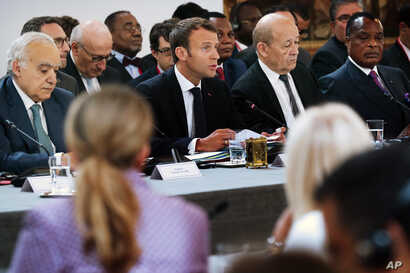 UN Special Envoy for Libya Ghassan Salame, French President Macron, French Foreign Affairs Minister Le Drian and Congo President Denis Sassou Nguesso, attend an International Conference on Libya at the Elysee Palace, May 29, 2018.