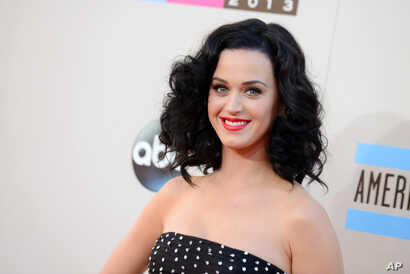 FILE - Katy Perry arrives at the American Music Awards at the Nokia Theater.