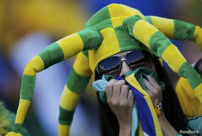 A fan of Brazil before the match against Chile at the Mineirao stadium in Belo Horizonte, June 28, 2014.