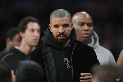 Rapper Drake attends an NBA basketball game between the Los Angeles Lakers and the Oklahoma City Thunder, Dec. 23, 2015, in Los Angeles.