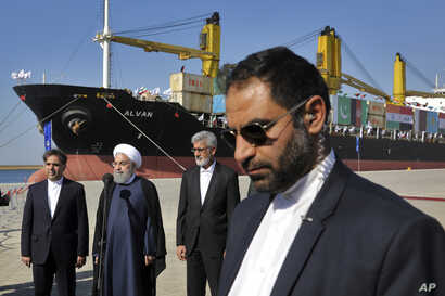 Iranian President Hassan Rouhani, second left, speaks during the inauguration a newly built extension of the port of Chabahar, near the Pakistani border, on the Gulf of Oman, southeastern Iran, Dec. 3, 2017.