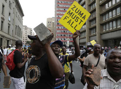 Members of the African National Congress (ANC) protest outside the party's headquarters in downtown Johannesburg, Feb. 5, 2018 calling for President Jacob Zuma to step down.