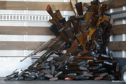 A small portion of guns that were turned in by their owners are stacked inside a truck at a gun buyback held by the Los Angeles Police Department  in Los Angeles, California, December 26, 2012 following the mass shooting at Sandy Hook Elementary Scho...