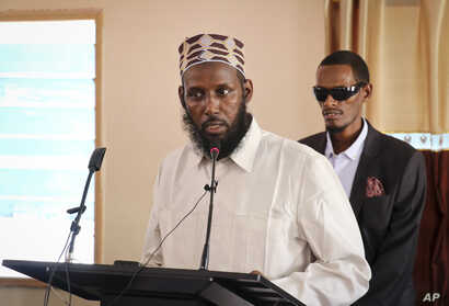 In this Oct. 10, 2018 photo, Mukhtar Robow, who was once deputy leader of Africa's deadliest Islamic extremist group the  al-Shabab, speaks at a press conference about his candidacy for a regional presidency, in Baidoa, Somalia.