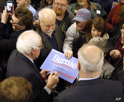 Democratic presidential candidate, Sen. Bernie Sanders, I-Vt. works the crowd after a rally at a local union hall in Janesville, Wisconsin, April 4, 2016.