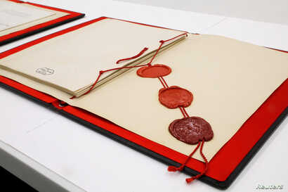 Official wax seals representing North Korea, China and the United Nations are seen on an original signed copy of the armistice agreement that ended the fighting between North and South Korea when signed in Panmunjom on July 27, 1953, as it sits in a ...