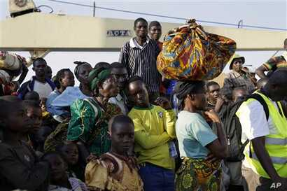 In this image taken Saturday May 23, 2015, refugees who fled Burundi's violence and political tension arrive in Kigoma, Tanzania, rafter making the journey on Lake Tanganyika. aT LEAST 144,000 have fled Burundi because they are afraid of getting caug...