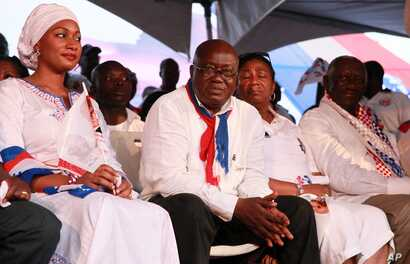 Opposition presidential candidate Nana Akufo-Addo, center, looks on from the stage during his final campaign rally ahead of Friday's presidential election, in Accra, December 5, 2012.