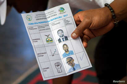 A polling staff member counts ballots at a polling center in Kigali, Rwanda, Aug. 4, 2017.