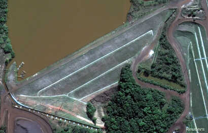 The dam at Vale's Corrego do Feijao mine near Brumadinho, Brazil, is pictured before its Jan. 25, 2019 collapse in this June 2, 2018 handout satellite photo.