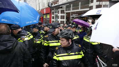 Security forces are needed at every public appearance of far-right leader Geert Wilders who has been living under 24-hour security protection since 2004, in Breda, Netherlands, March 2017. (M. van der Wolf/VOA)