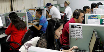 Call center agents work overnight daily to cater to United States clients in Manila's Makati financial district, Feb. 6, 2012.