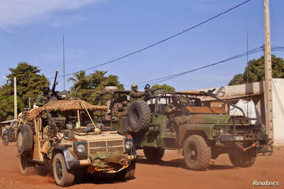French Elite Special Operations soldiers drive through Markala, about 275 kilometers from Bamako, Mali, January 15, 2013.