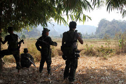 FILE -  Soldiers of Karen National Union (KNU) stand guard in Hpa-an village, Karen State, Myanmar.