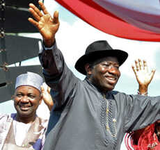 Nigerian President Goodluck Jonathan waves to the crowd before their campaign declaration in Abuja on September 18, 2010.