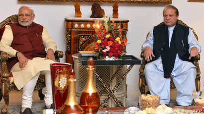 Indian Prime Minister Narendra Modi, left, and Pakistan Prime Minister Nawaz Sharif meet in Lahore after Modi paid a surprise visit, Dec. 25, 2015.