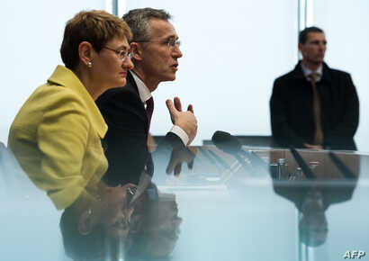 FILE - NATO Secretary-General Jens Stoltenberg, with NATO spokeswoman Oana Lungescu, addresses reporters in Berlin, Jan. 14, 2015.