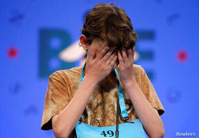 Daniel Larsen, 13, of Bloomington, Indiana, struggles during the 2017 Scripps National Spelling Bee at National Harbor in Oxon Hill, Md., May 31, 2017.