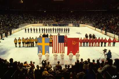 U.S., Swedish, and Soviet teams lined up to receive their Olympic gold, bronze, and silver medals, Lake Placid, N.Y., February 24, 1980.