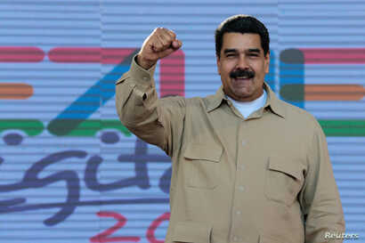 Venezuela's President Nicolas Maduro gestures during a meeting with supporters in Caracas, March 31, 2017. (Miraflores Palace/Handout)