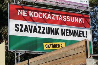"Two days before Hungary votes on whether it will reject European Union mandated refugee minimums, this poster urges people to vote ""no,"" Sept. 30, 2016. (VOA/H. Murdock)"