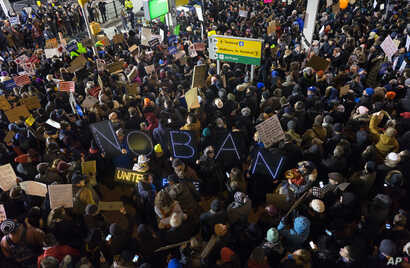 Protesters assemble at John F. Kennedy International Airport in New York, Jan. 28, 2017, after earlier in the day two Iraqi refugees were detained while trying to enter the country.